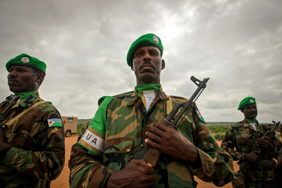 Soldiers of the Djiboutian Contingent serving with the African Union Mission in Somalia (AMISOM) stand to attention during the arrival of further troops to the central Somali town of Belet Weyne, 16 November 2012, approx. 300km north west of the Somali capital Mogadishu. The air lift is part of a deployment to begin boosting the just over 300 personnel already on the ground to approx. 1,000 troops serving under the UN-supported AU mission in Somalia. AU-UN IST PHOTO / STUART PRICE.